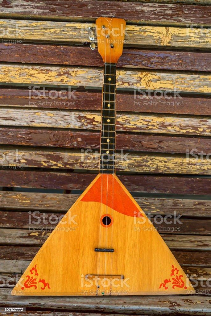 Musical instrument balalaika on wooden background stock photo