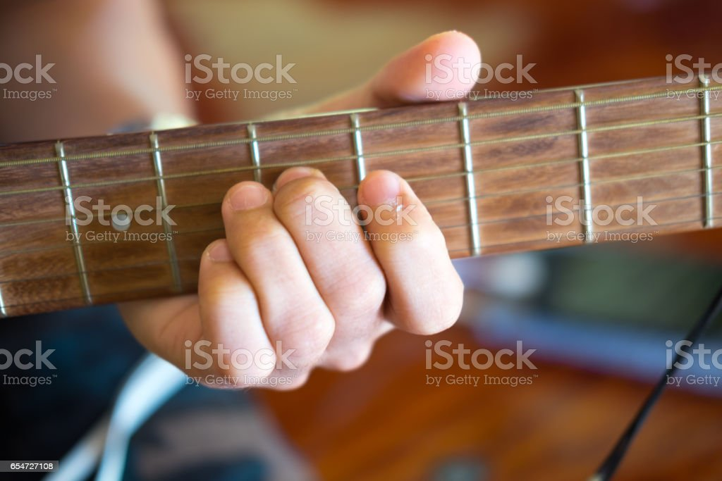 Musical instrument with performer hand stock photo