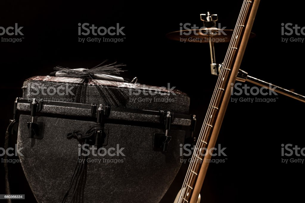musical instruments, acoustic guitar and bass guitar and percussion instruments drums stock photo