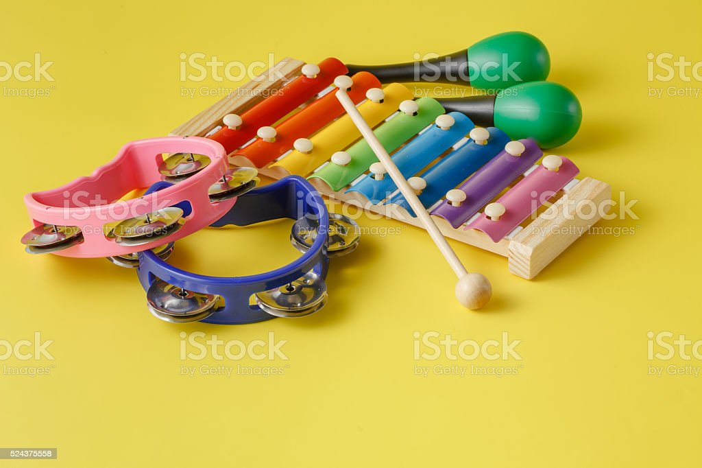 Musical instruments collection on yellow background stock photo