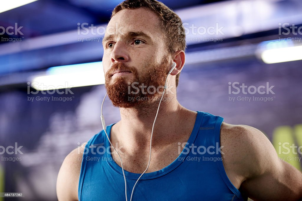Musical motivation for his workout stock photo