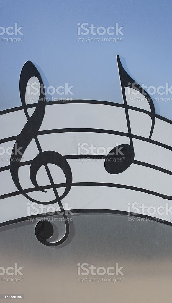 Musical Note and Clef on Multi-colored Background royalty-free stock photo