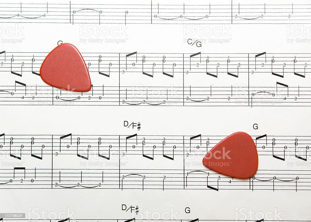 Musical notes and guitar picks royalty-free stock photo