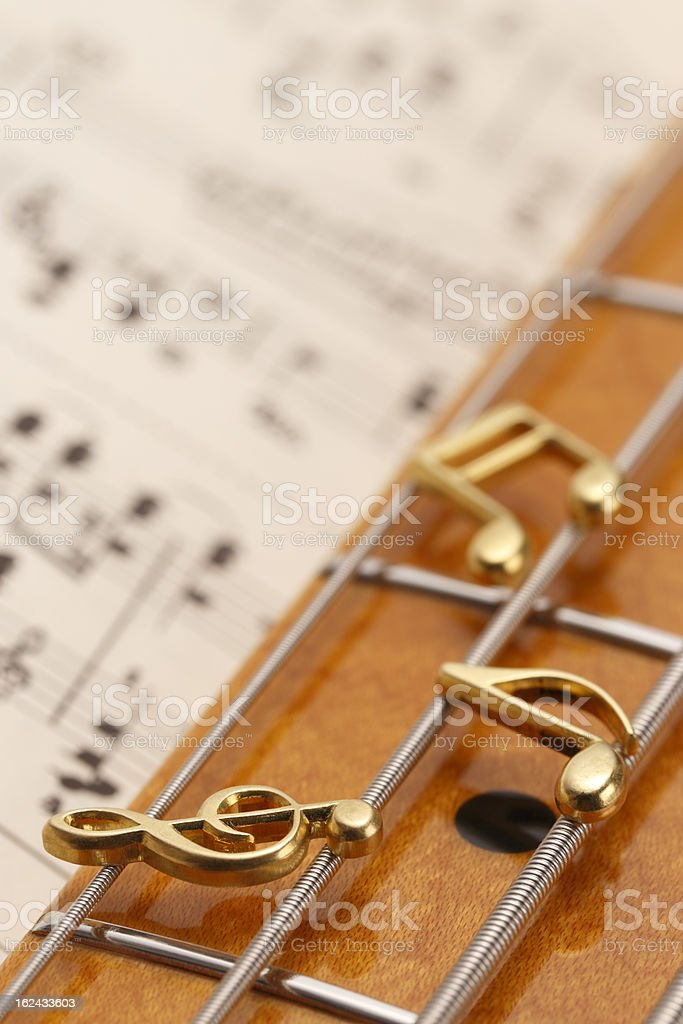Musical notes on bass guitar royalty-free stock photo