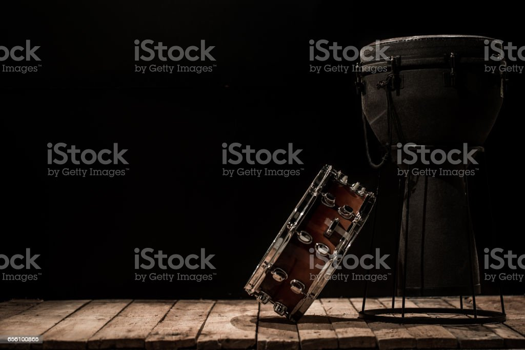 musical percussion instruments on black background drum Bongo and snare stock photo