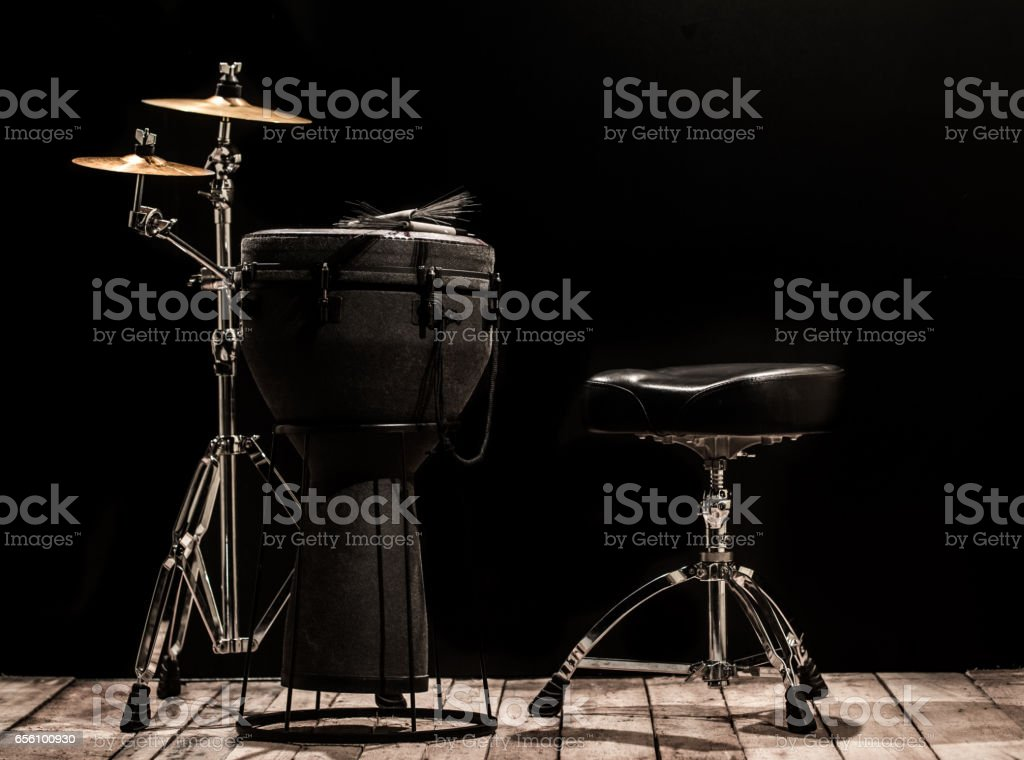 musical percussion instruments on black background stock photo