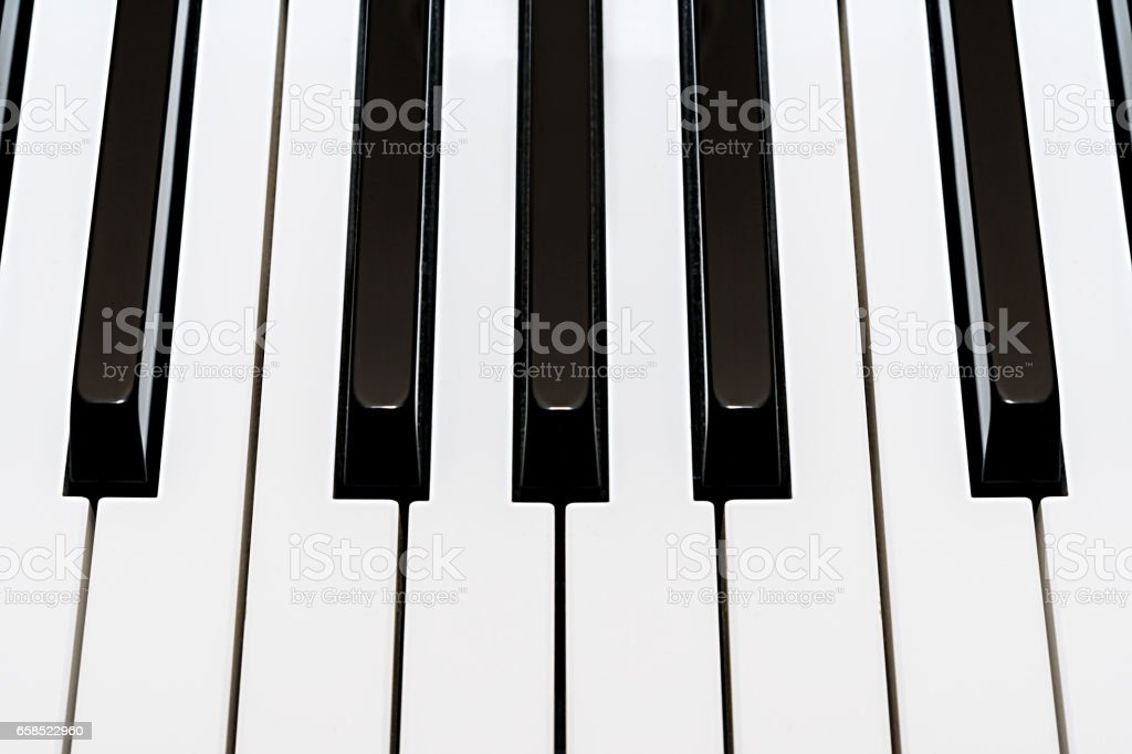 Musical piano keyboard white and black stock photo