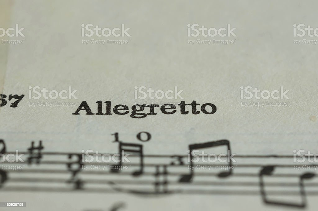 Musical speed Allegretto on the textbook page stock photo