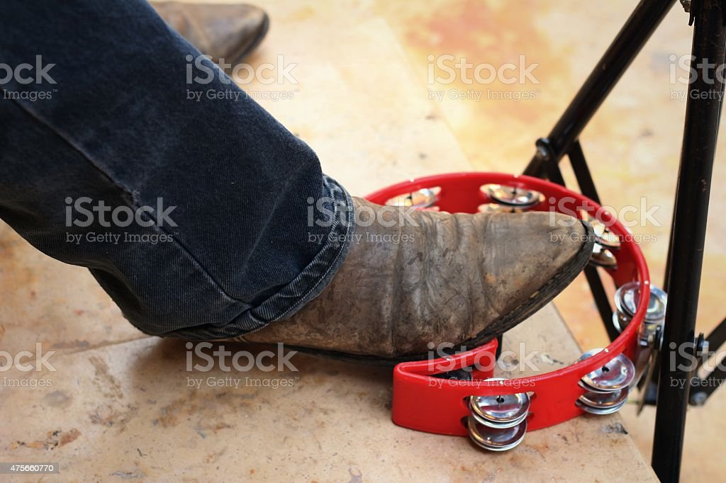 Musician are using a foot knocked tambourine stock photo