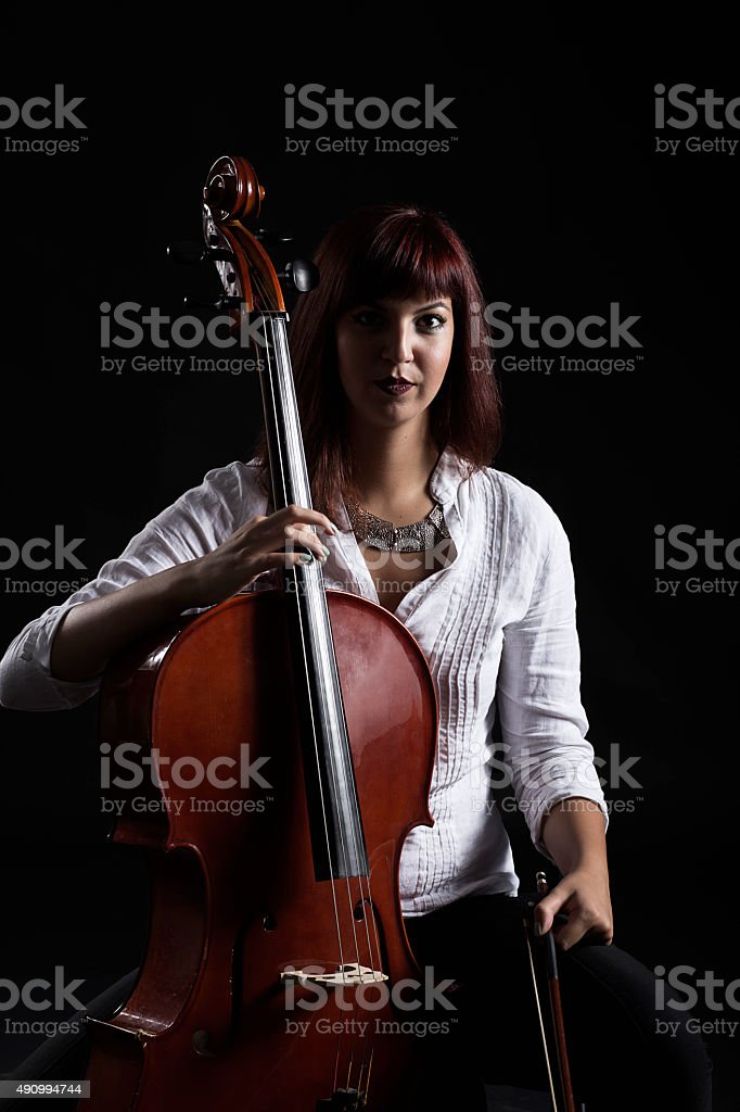 musician cellist playing stock photo