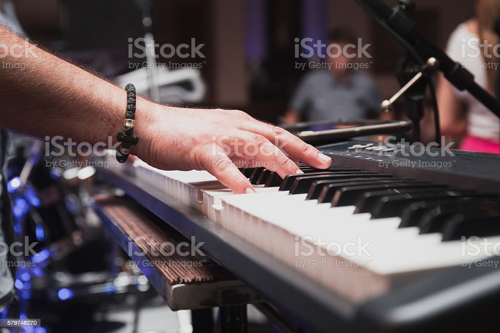 Musician hand on Keyboard with Blur Background stock photo