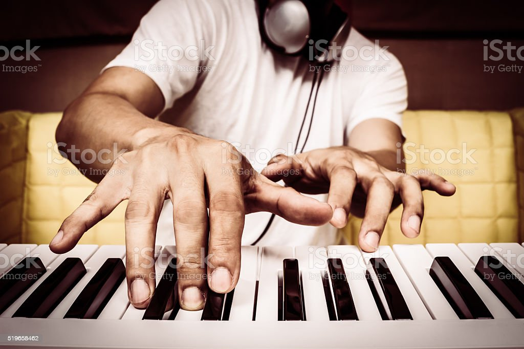 musician hands playing white piano stock photo
