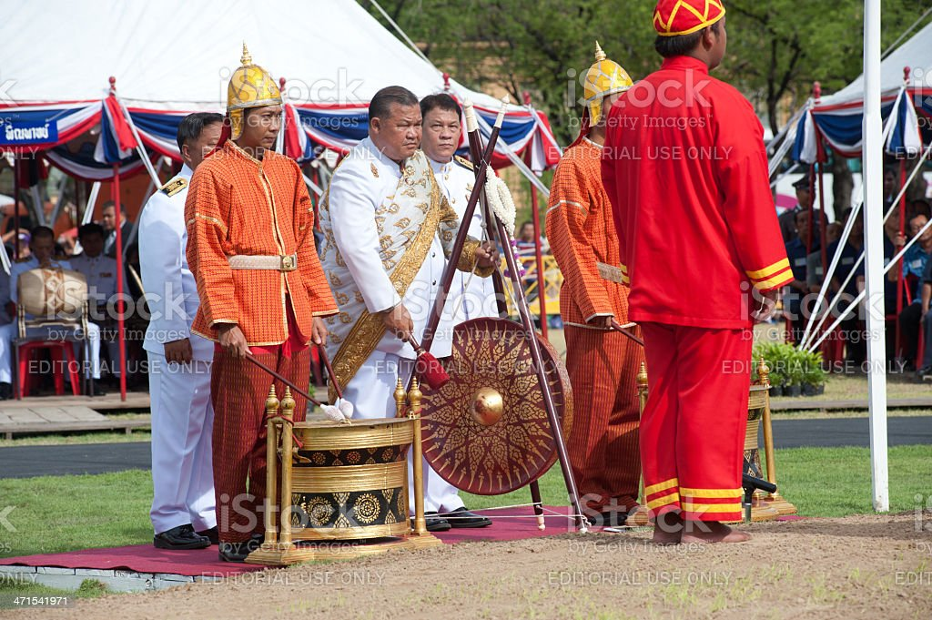 Musician hitting gong in Royal Plowing Ceremony. royalty-free stock photo