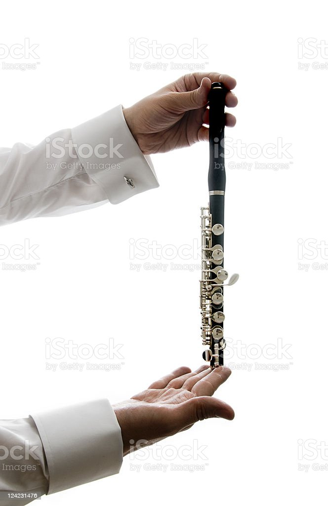 Musician holding piccolo stock photo