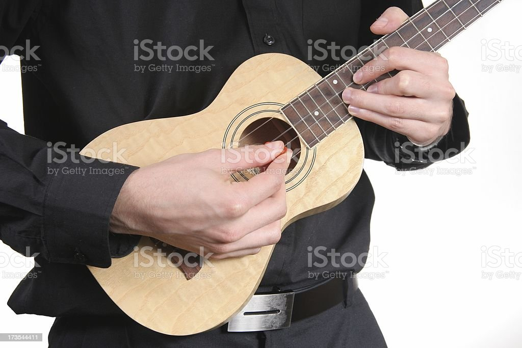 Musician in Black plays ukulele stock photo