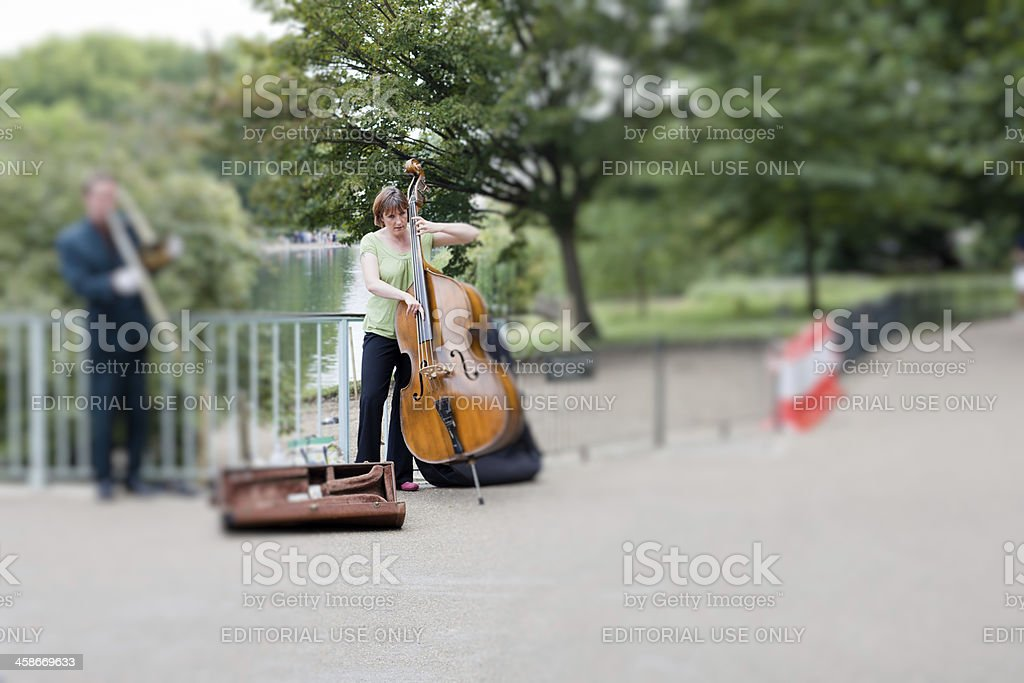 Musician in St. James's Park Playing Trumpet and Cello, London royalty-free stock photo