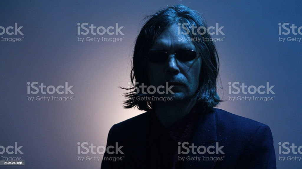 musician in the jacket and black glasses stock photo