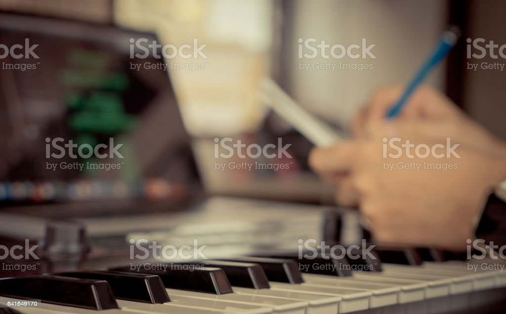 Musician in writing music song in his home studio stock photo