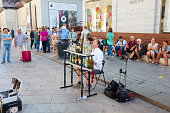 Musician is playing music on the  glass bottles in Milan.