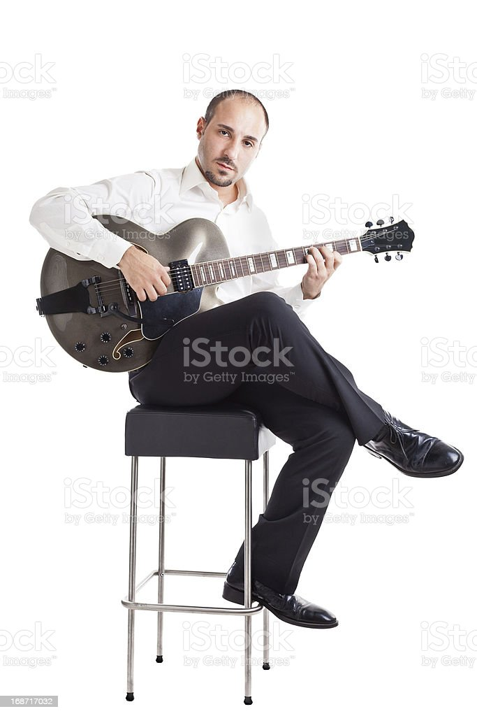 Musician on a stool stock photo