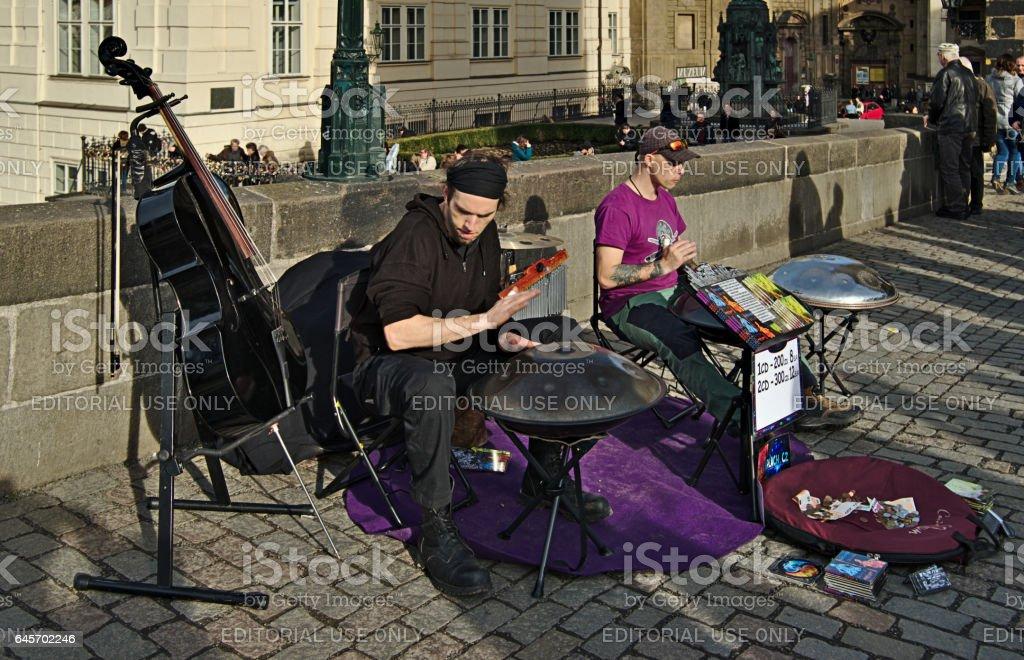 Musician on Charles Bridge in Prague stock photo