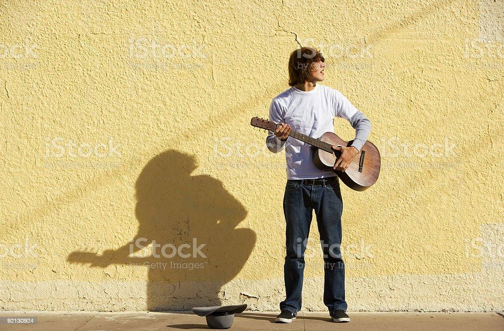 Musician on Sidewalk stock photo