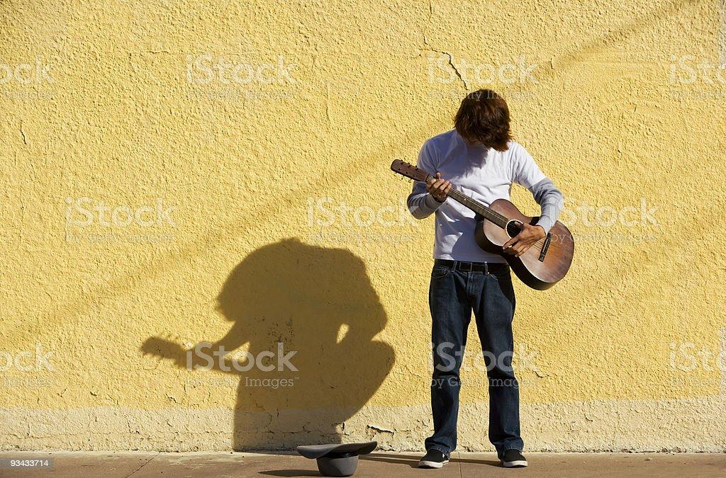 Musician on Sidewalk royalty-free stock photo