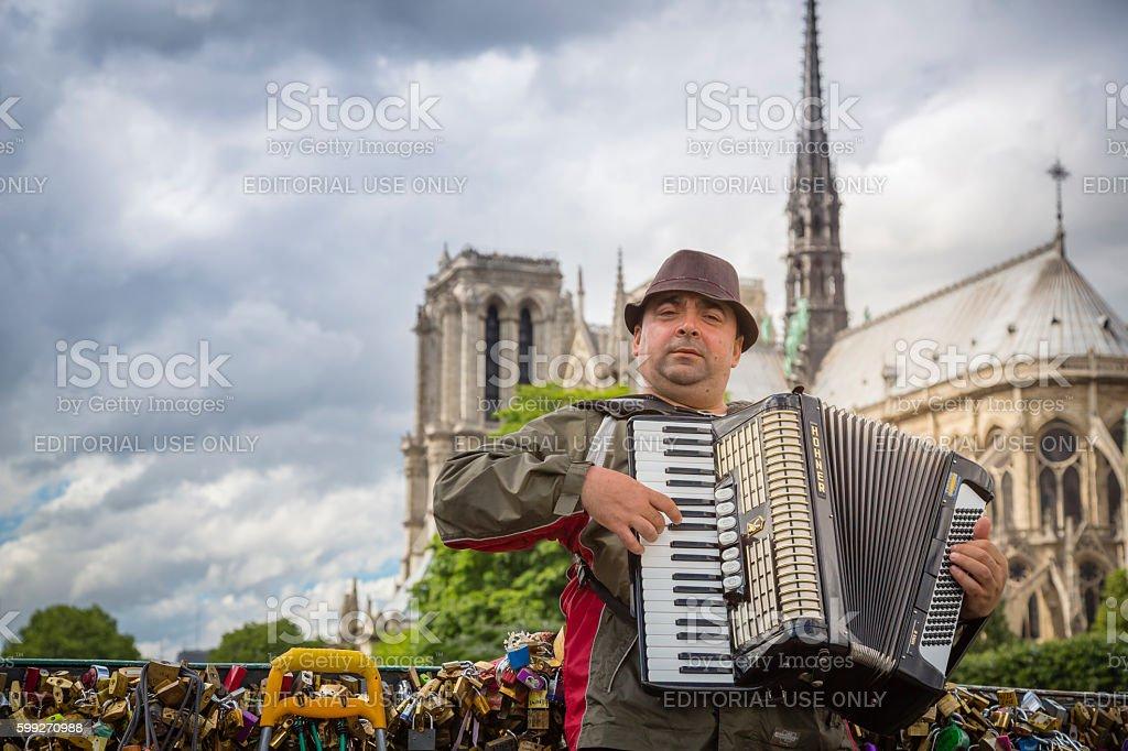Musician on the bridge of Arts, Paris, France stock photo