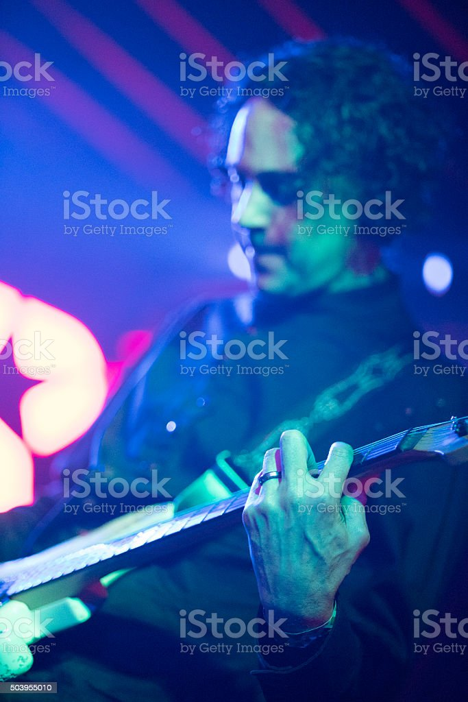 Musician play guitar on the stage in a live performance stock photo
