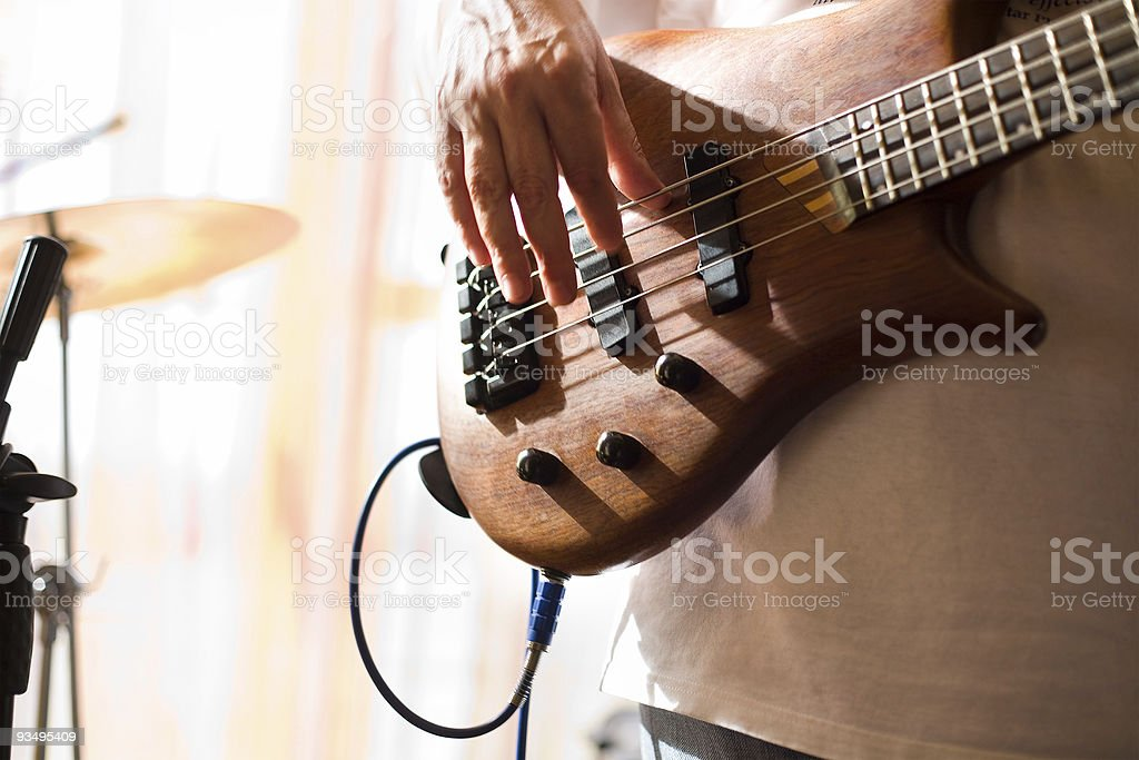 Musician play on bass guitar #3 royalty-free stock photo