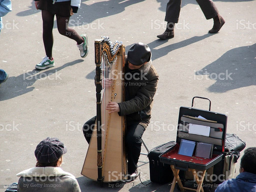 Musician playing a harp royalty-free stock photo