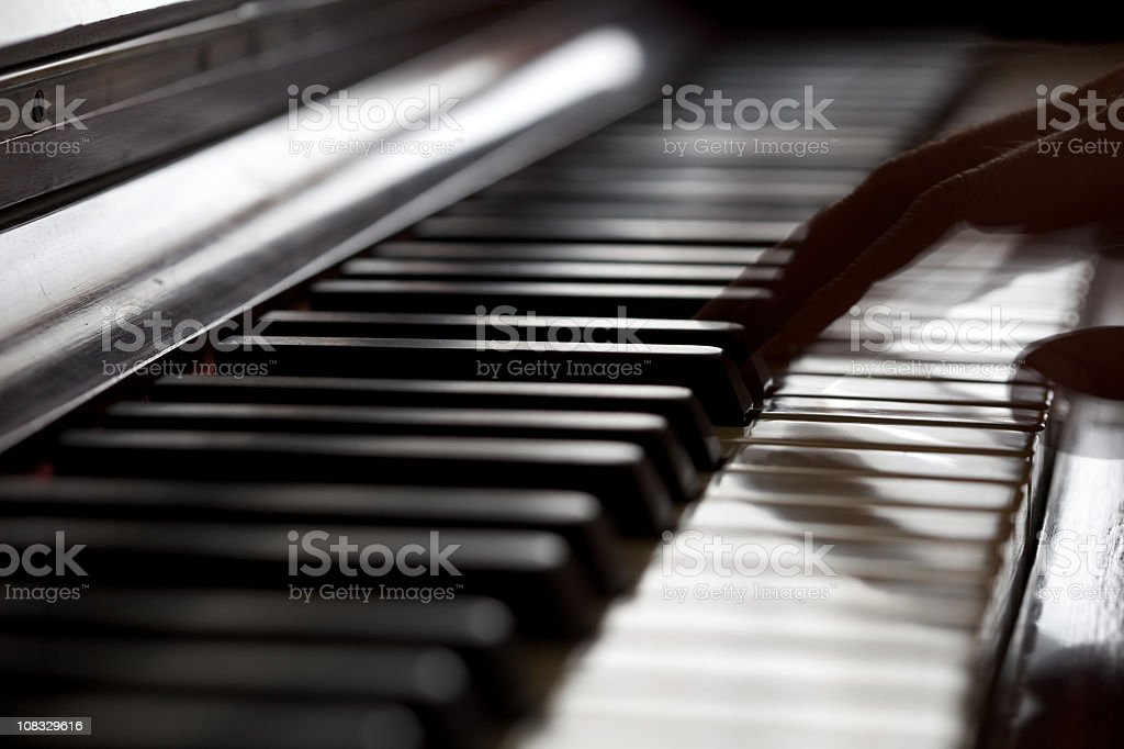 Musician playing a piano - blurred motion fingers. stock photo