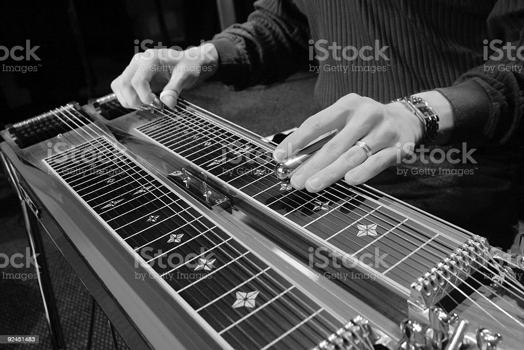 Musician Playing a Steel Guitar During a Concert royalty-free stock photo