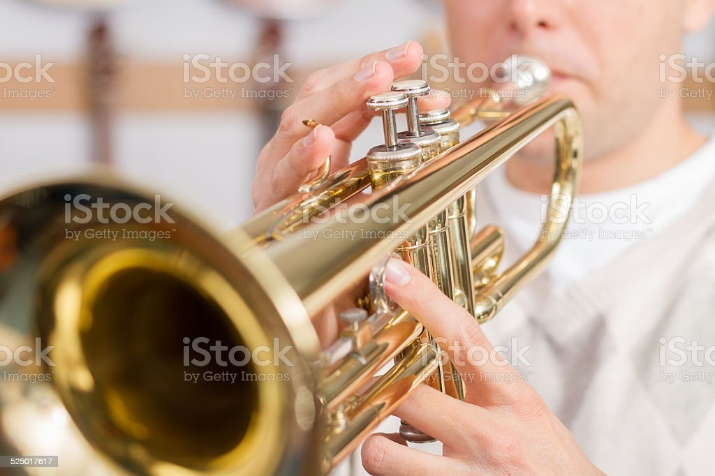 Musician playing a trumpet stock photo