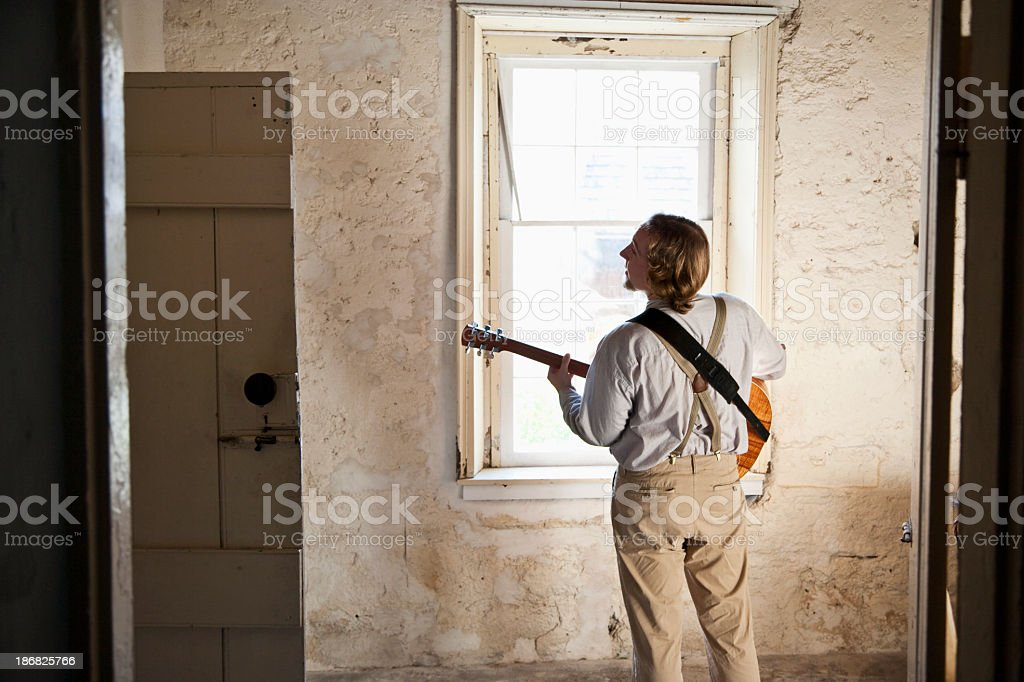 Musician playing alone royalty-free stock photo