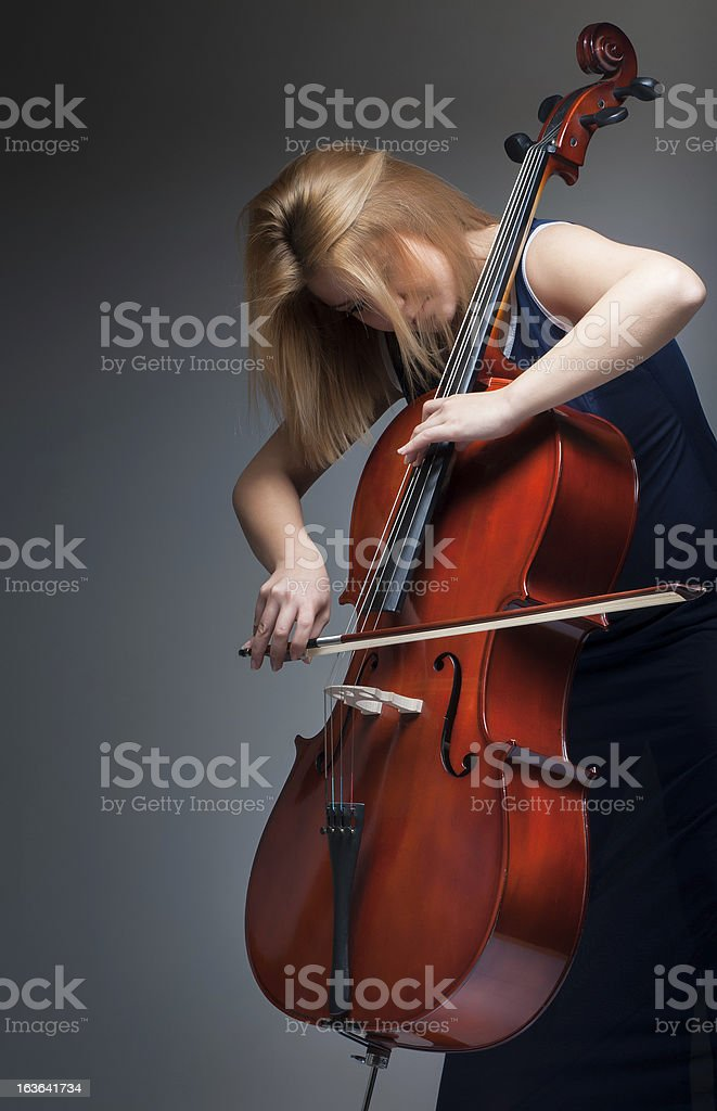 Musician playing cello royalty-free stock photo