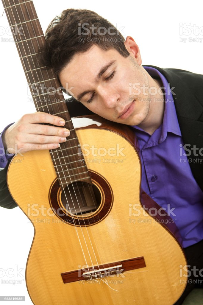 Musician playing classical guitar stock photo