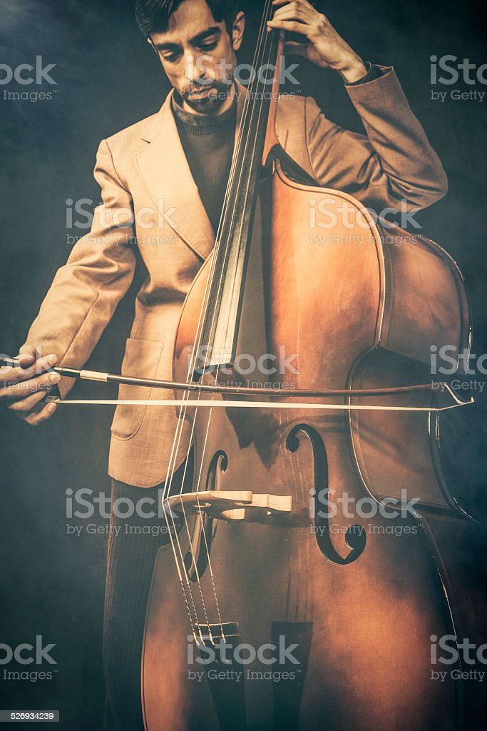 Musician playing double bass stock photo