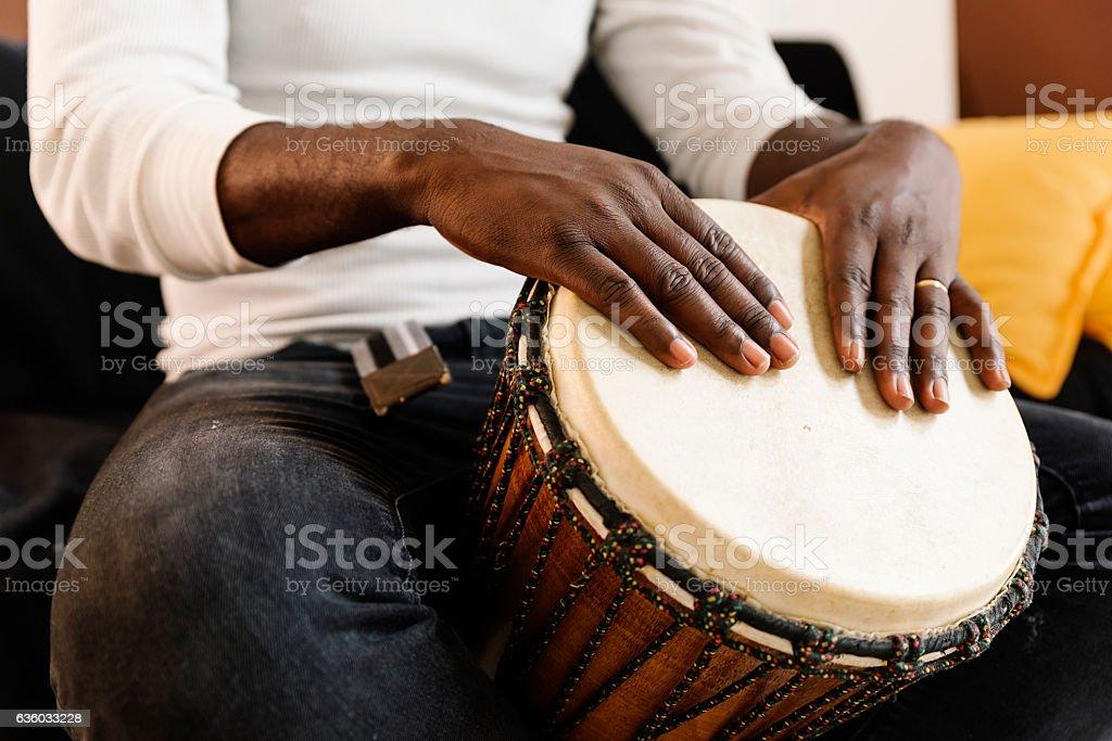 Musician Playing Drum. stock photo