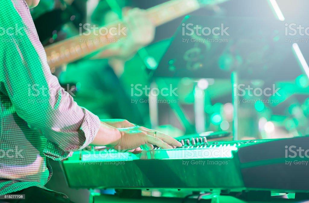 musician playing electronic keyboard, selective focus stock photo