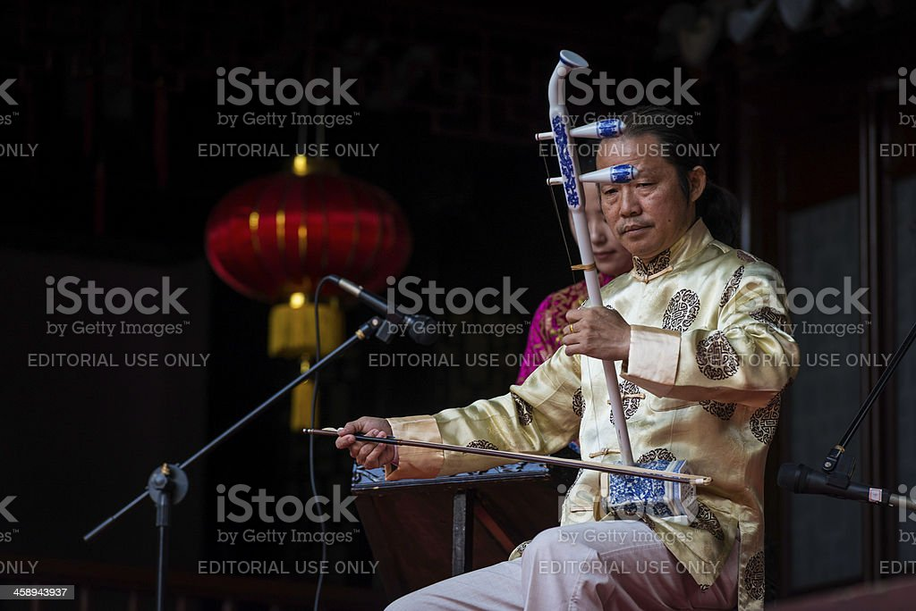 Musician playing Erhu traditional Chinese instrument Shanghai royalty-free stock photo