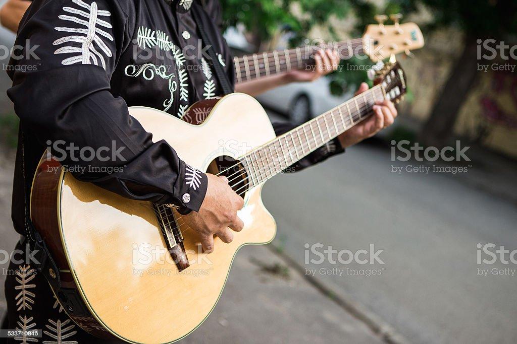 musician playing guitar stock photo