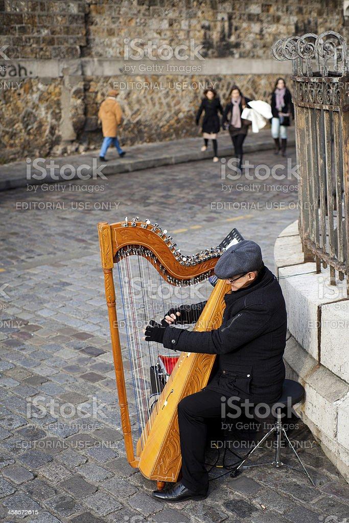 Musician Playing Harp in Montmartre, Paris stock photo