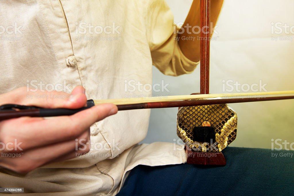 Musician playing in erhu. stock photo