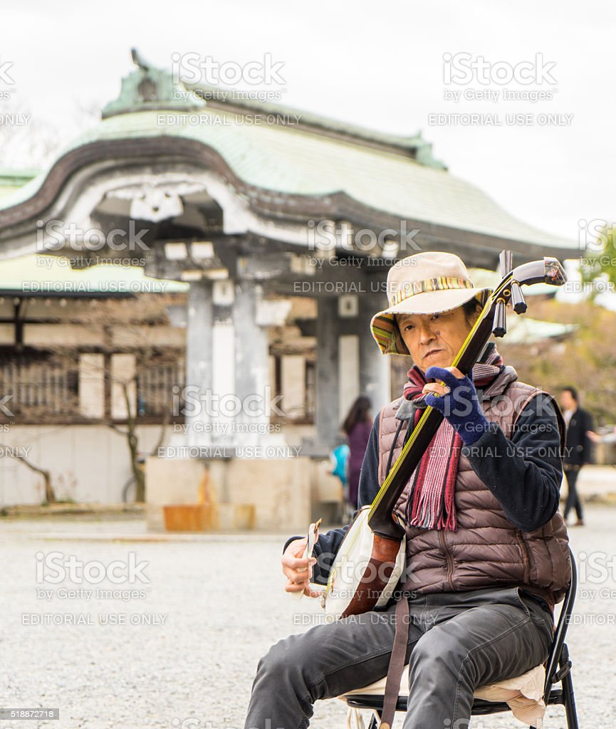 Musician playing japanese music in Osaka Castle stock photo