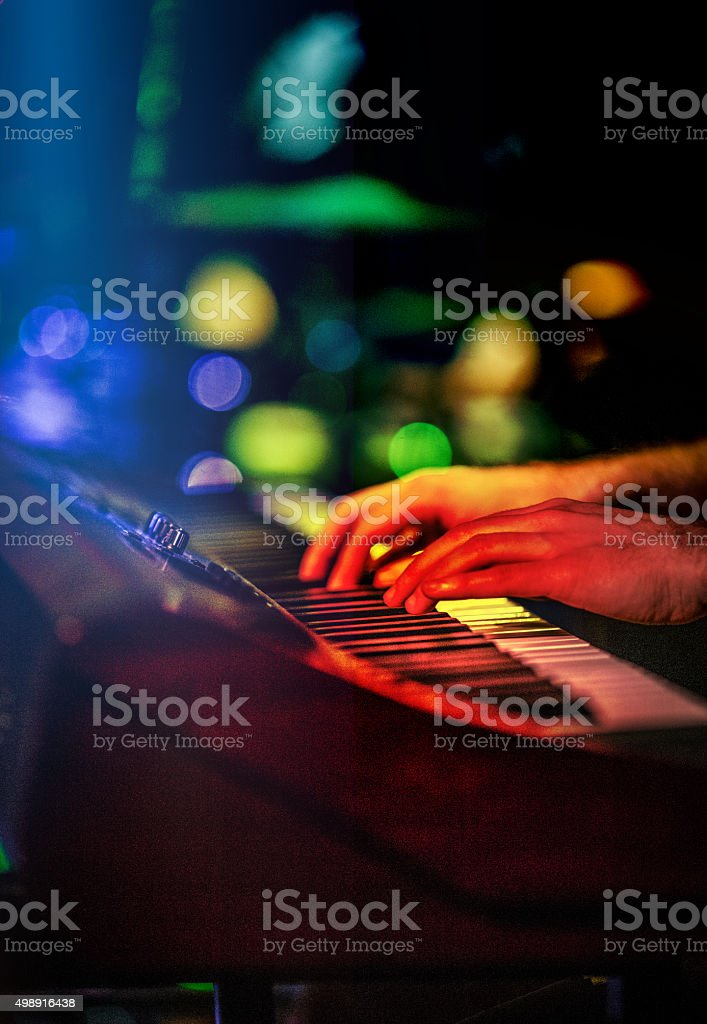 Musician playing Keyboard / Synthesizer in Concert stock photo