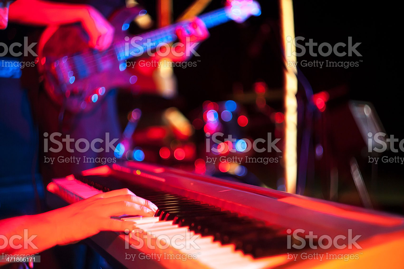 Musician playing on electric keyboard at jazz music festival royalty-free stock photo