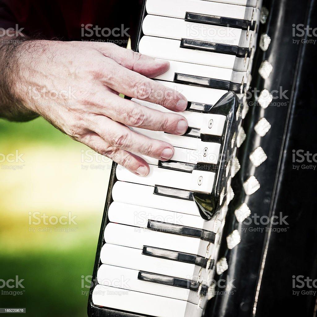 Musician playing piano accordion stock photo