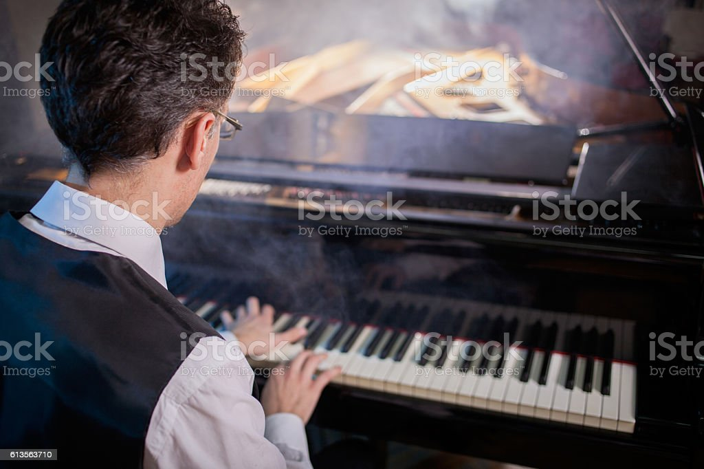 musician playing the grand piano stock photo