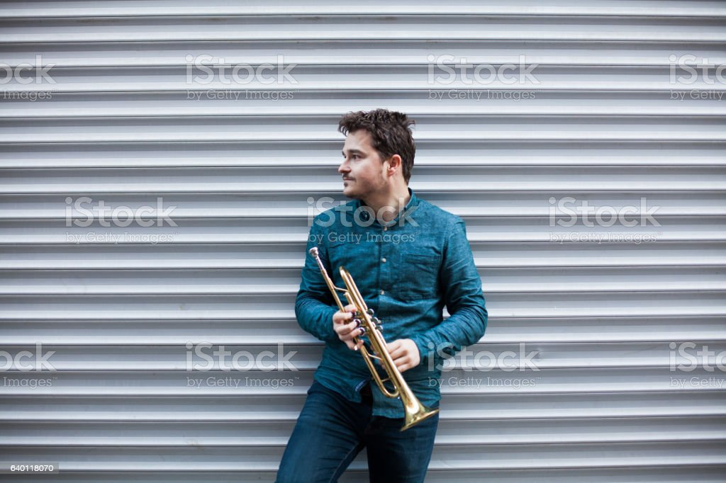 Musician playing trumpet stock photo